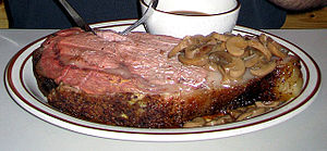 A slice of prime rib from a standing rib roast...