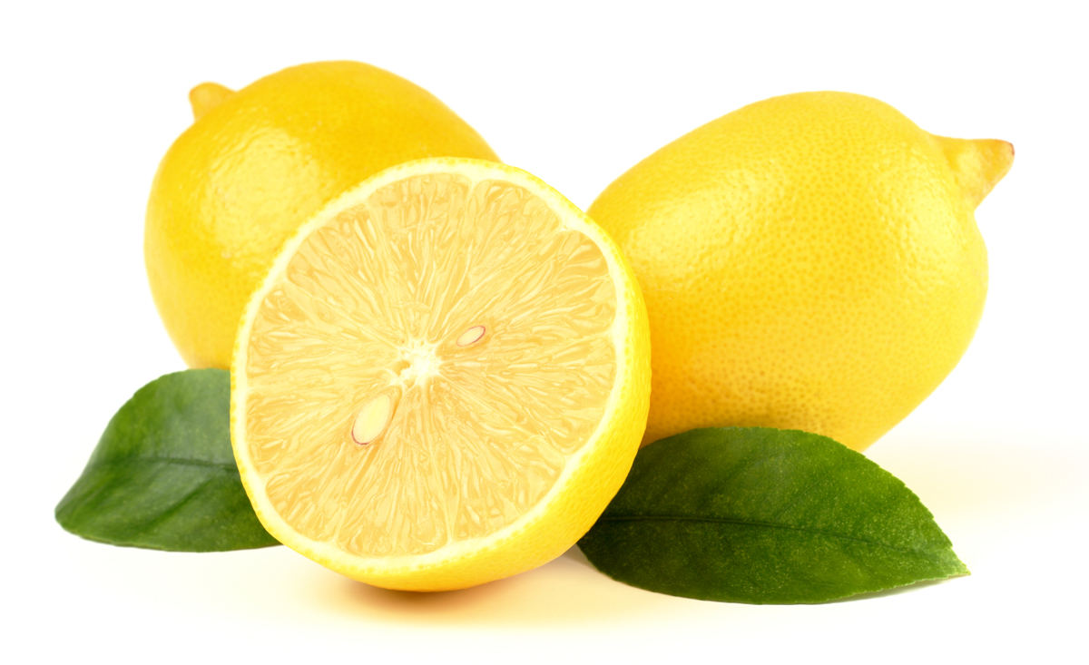Group of lemons with leaves, isolated over white
