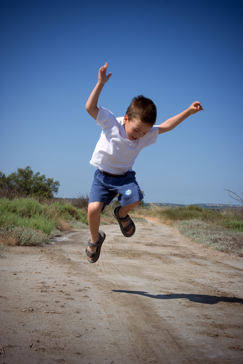 happy jumping child in summer