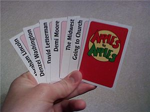 Seven red cards with one backwards showing the...