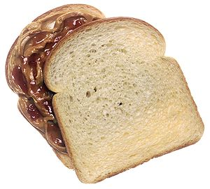 a peanut butter and jelly sandwich, top slice ...