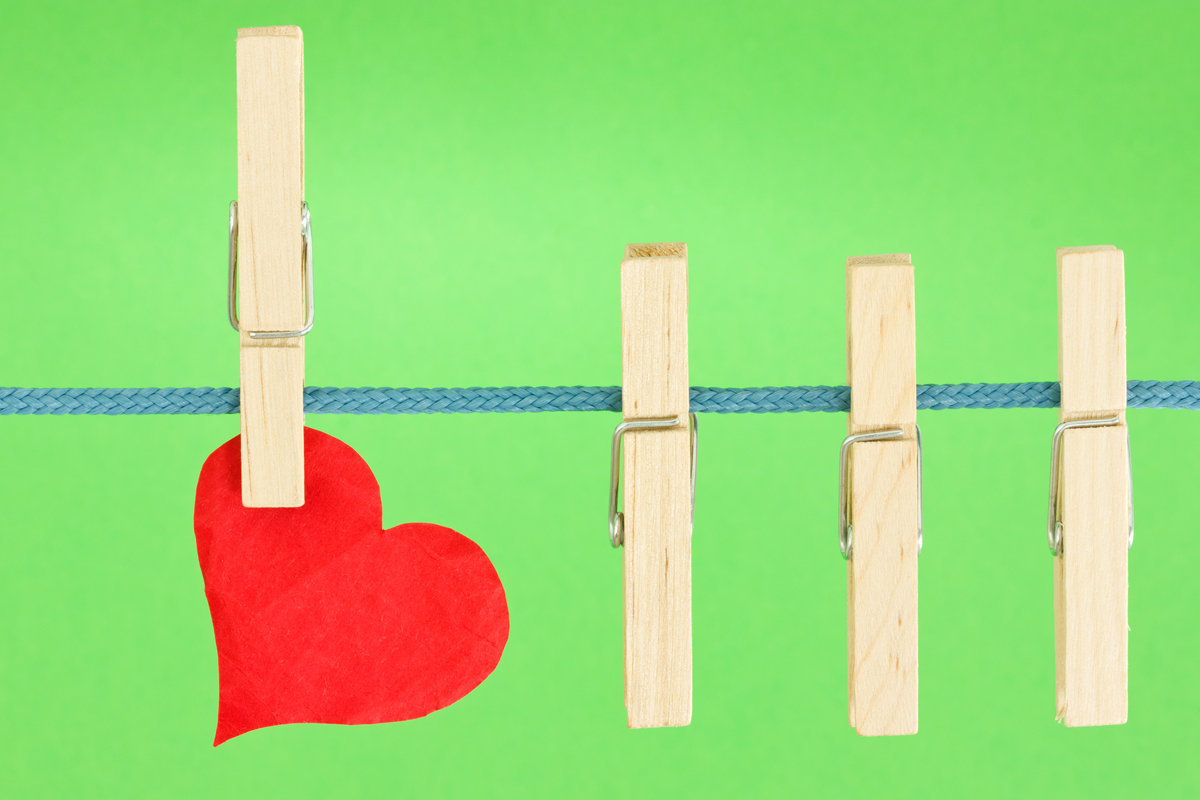 clothesline with a red heart, hung on green background