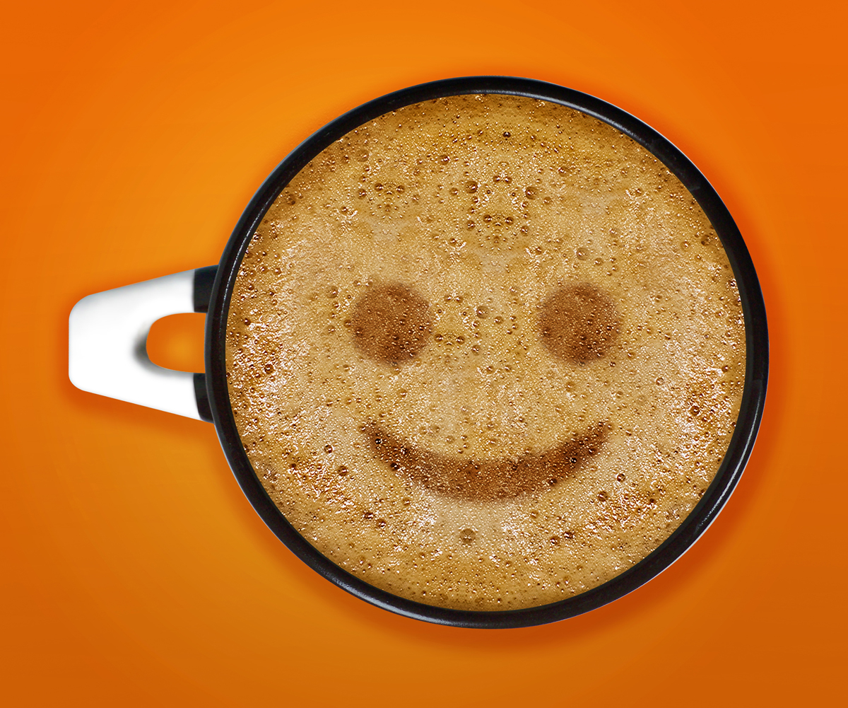 coffee art, A cup of cappuccino with smile face sign pattern in a cup on Orange background.