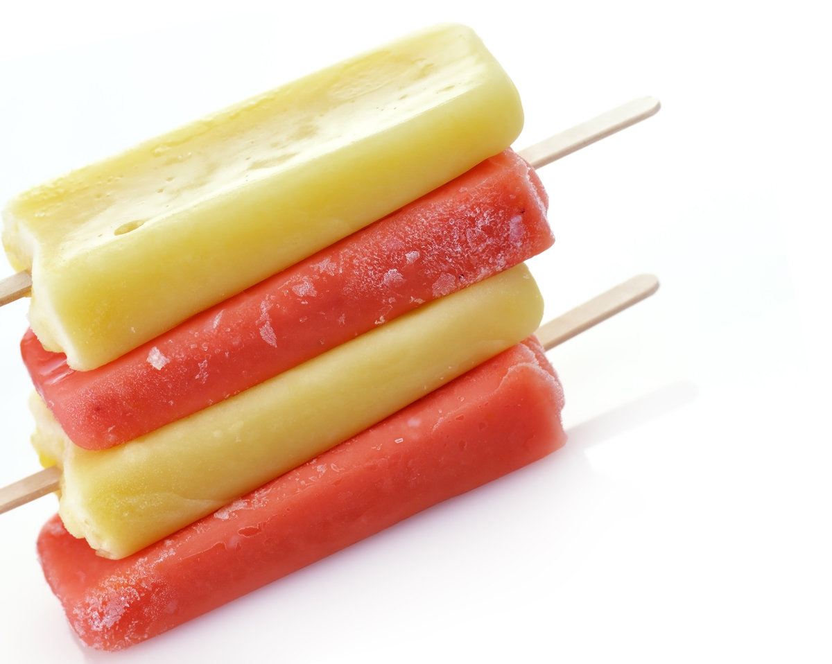 colorful ice cream pops on white background